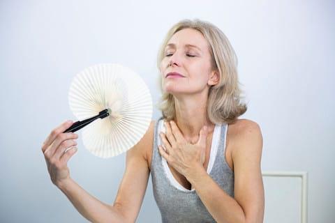 women having hot flushes during menopause
